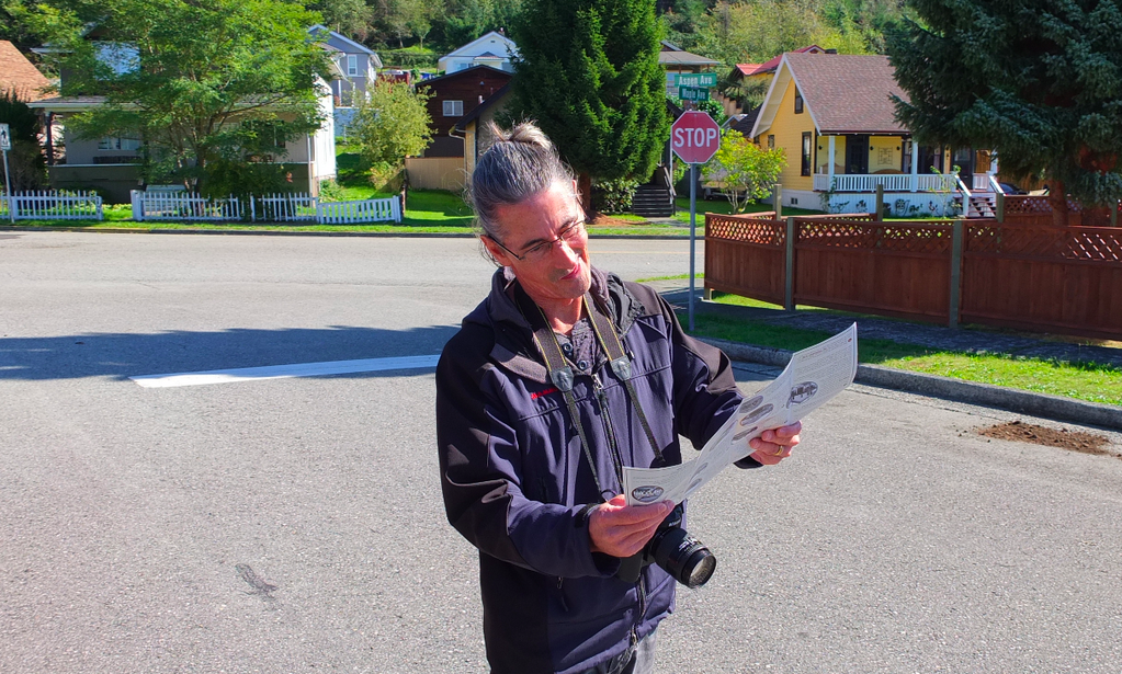 Joel looking at a map of Powell Rivers Historic Townsite during our photographic walking tour.