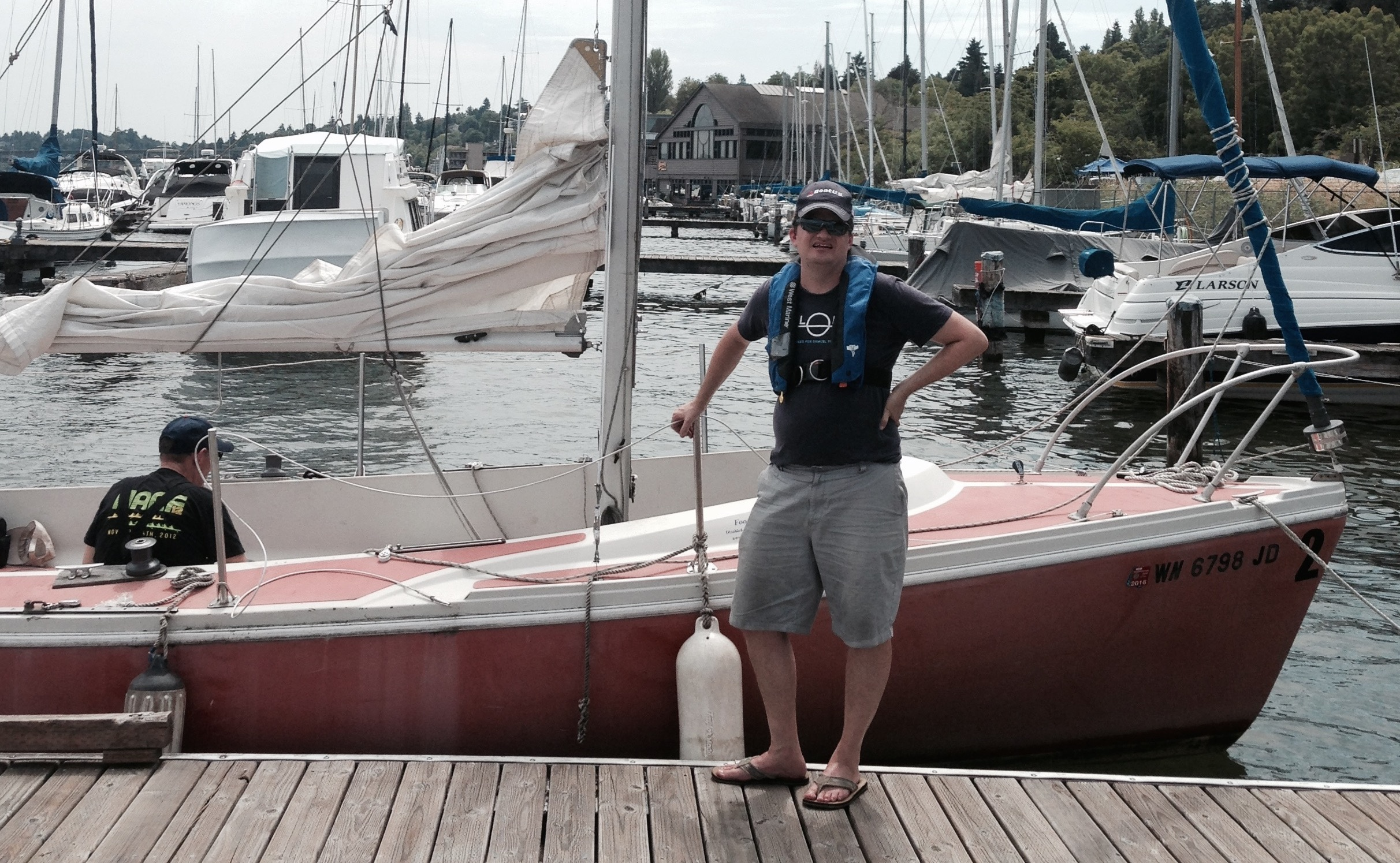 Robert Dall standing infront of a Columbia 21 at the Footloose Disabled Sailing Association